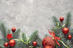 Green and red Cristmas background with fir twigs, Christmas trin Stock Images