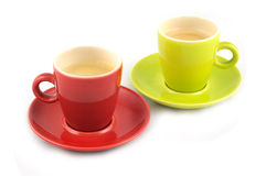 Green and red cup of coffee. Isolated on white background stock photography