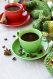 Green and red cups of coffee with coffee Bence, anise star Royalty Free Stock Photography