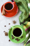 Green and red cups of coffee with coffee Bence, anise star Stock Photo