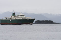Green and Red Ferry in Alaska Stock Images