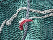 Green and red fishnet. Foreground of Green and red fishnet royalty free stock photo