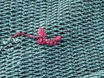 Green and red fishnet. Texture stock photos