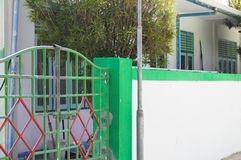 Green and red gate of a maldivian house stock images