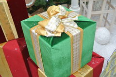 Green and red gift boxes with gold ribbon Royalty Free Stock Images