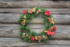 Green with red and gold Christmas conifer wreath Royalty Free Stock Photos