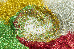 Green, red, gold, and silver background from tinsels with bokeh royalty free stock images