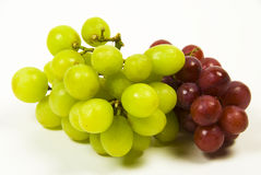 Green and red grapes. Large bunch of ripe green and red juicy seedless grapes Royalty Free Stock Images