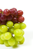 Green and red grapes. Large bunch of ripe green and red juicy seedless grapes Royalty Free Stock Photography