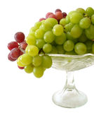 Green and red grapes on tray isolated Royalty Free Stock Photos