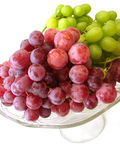 Green and red grapes on tray isolated Stock Image