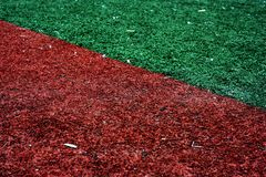 American baseball in-field. Softball or baseball in-field, Vibrant red and green grass Red And Green Grass Stock Photos