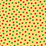 Green and red hand drawn scattered polka dot pattern on yellow background. Seamless vector design with modern vibe stock photo