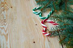 Green red hearts of candy cones with Christmas tree branches on the right side. New year or Valentines day sweets decorations stock photography
