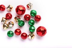 Green and Red Holiday Ornaments and Bells on a white background. In random arrangement stock photos