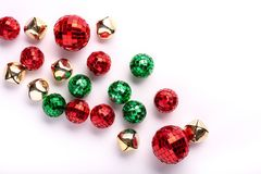 Green and Red Holiday Ornaments and Bells on white background. Top view royalty free stock images
