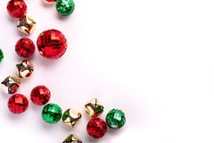 Green and Red Holiday Ornaments and Bells on white background. Top view stock image