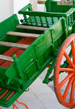 Green red horse-drawn carriage. Green wooden horse-drawn carriage with red wheels Stock Photo