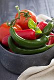 Green and red hot pepper on table Royalty Free Stock Images