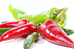 Green and red hot peppers. Horizontal color view of red and green hot anaheim, serrano and jalapeno peppers Royalty Free Stock Images