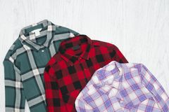 Green, red and lavender plaid shirts. Fashionable concept.  stock photos