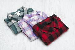 Green, red and lavender plaid shirts. Fashionable concept.  royalty free stock photo