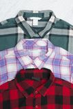 Green, red and lavender plaid shirts. Fashionable concept.  stock images