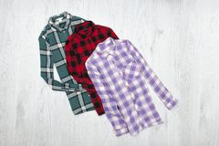 Green, red and lavender plaid shirts. Fashionable concept.  stock image