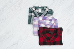 Green, red and lavender plaid shirts. Fashionable concept.  royalty free stock photos