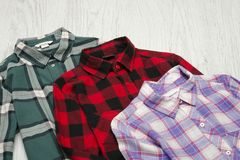 Green, red and lavender plaid shirts. Fashionable concept.  royalty free stock images