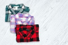 Green, red and lavender plaid shirts. Fashionable concept. Space for text.  Stock Photos