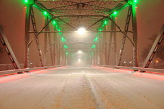 Green and Red Lights on Snow Coverd Bridge. Night Shot on a bridge over the Red River in a Blizzard. Sorlie Memorial Bridge in Grand Forks, North Dakota Stock Photo