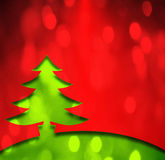 a green and red metal christmas tree with bokeh added Stock Photo