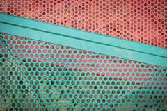 Green and red metal sieve Royalty Free Stock Image
