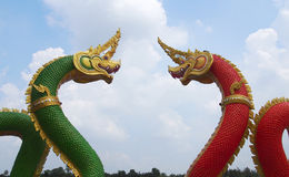 Green and red Nagas. With blue sky background Stock Image