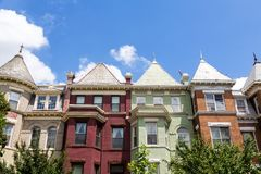 Green, red, and orange row houses in Washington DC on a summer day. Royalty Free Stock Photo