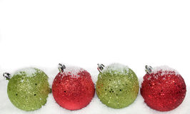 Green and red ornaments. On a white background Stock Photography