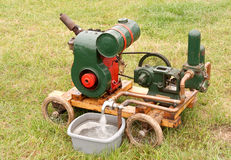 Green & red painted old water pump Royalty Free Stock Images