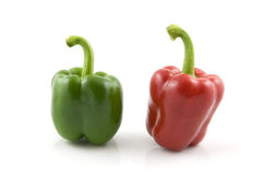 Green and red paprika. Isolated on white background Royalty Free Stock Images