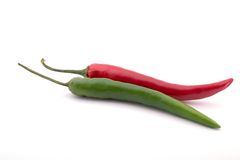 Green and red pepper. Isolated on white Royalty Free Stock Photos