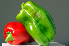 Green and red pepper. Close-up Stock Images
