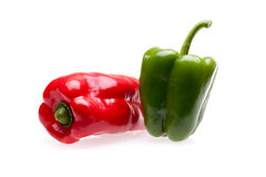 Green And Red Pepper Over White royalty free stock photography