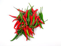 Green and red pepper on a white background. Green and red pepper isolated on a white background Stock Photo