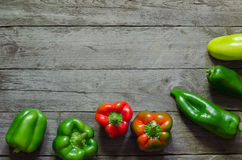 Green and red pepper on wooden background Stock Photography