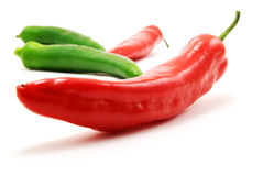 Green and red peppers. Isolated on white background stock image