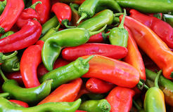 Green and red peppers, background. A detailed view of some green and red peppers, at the market, landscape cut royalty free stock photography