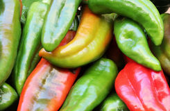 Green and red peppers. A detailed view of some green and red peppers, at the market, landscape cut stock photos