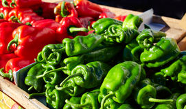 Green and red peppers in the market Stock Photography