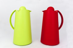 Green and red plastic water jug Royalty Free Stock Photos