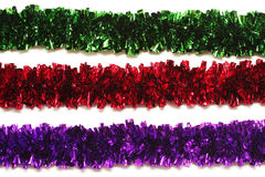 Green, red and purple tinsel isolated on white Stock Images